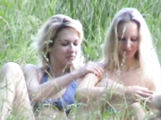 Stunning Lesbians Play Outdoors In The Grass